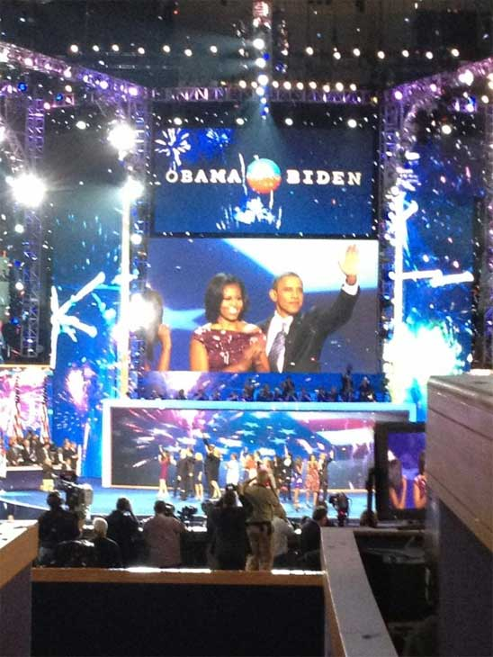 President Barack Obama and the first lady can be seen on a big screen at the Democratic National Convention in Charlotte, N.C., on Thursday, Sept. 6, 2012.