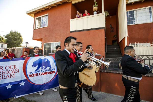 Members of the mariachi band &#34;Gallos de Jalisco&#34; serenade California citizens to get out and cast their vote on Tuesday, Nov. 6, 2012 in the Sun Valley district of Los Angeles.  <span class=meta>(AP Photo&#47; Damian Dovarganes)</span>