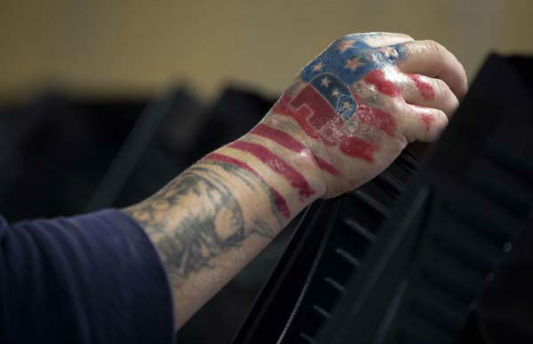 A brand new tattoo showing his choice of political party is seen on the right hand of Victor &#34;The Snake Mann&#34; Wolder as he votes on Election Day, Tuesday, Nov. 6, 2012, in Las Vegas.  <span class=meta>(AP Photo&#47; Julie Jacobson)</span>