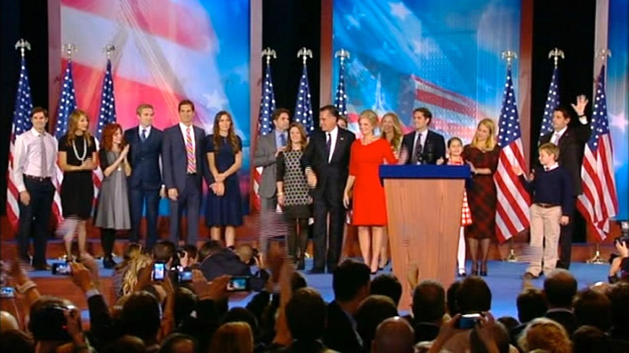 Republican presidential candidate Mitt Romney and Paul Ryan stand on stage with their families following Romneys concession speech at his election headquarters on Wednesday, Nov. 7, 2012.