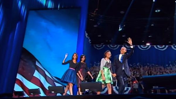 President Barack Obama appears on stage with wife, Michelle, and daughters Sasha and Malia, before the president's victory speech at election headquarters in Chicago on Wednesday, Nov. 7, 2012.