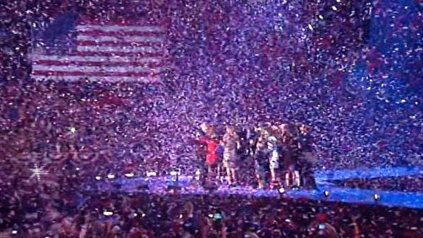 A flurry of confetti is seen falling across the room as the Obama and Biden families appear on-stage following President Barack Obama's victory speech in Chicago on Wednesday, Nov. 7, 2012.