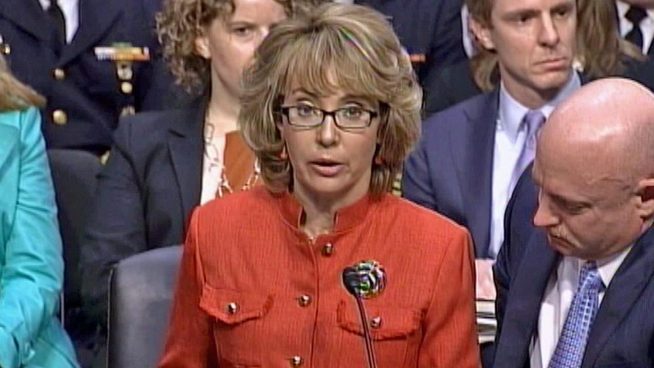 Former Congresswoman Gabrielle Giffords, who was injured in the mass shooting that killed six in Arizona two years ago, speaks during a Senate Judiciary Committee hearing next to her husband, retired astronaut Mark Kelly, Wednesday, Jan. 30, 2013.