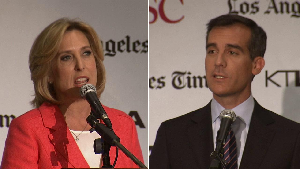 Los Angeles mayoral candidates Wendy Greuel (left) and Eric Garcetti (right) took part in a debate at the University of Southern California on Sunday, May 5, 2013.