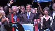 Eric Garcetti is shown raising his hands behind a podium in thsi May 2013 photo.