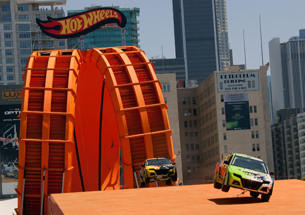 Team Hot Wheels green driver Greg Tracy and yellow driver Tanner Foust set a Guinness World Records title by successfully racing through a 60-foot-tall double vertical loop at the X Games L
