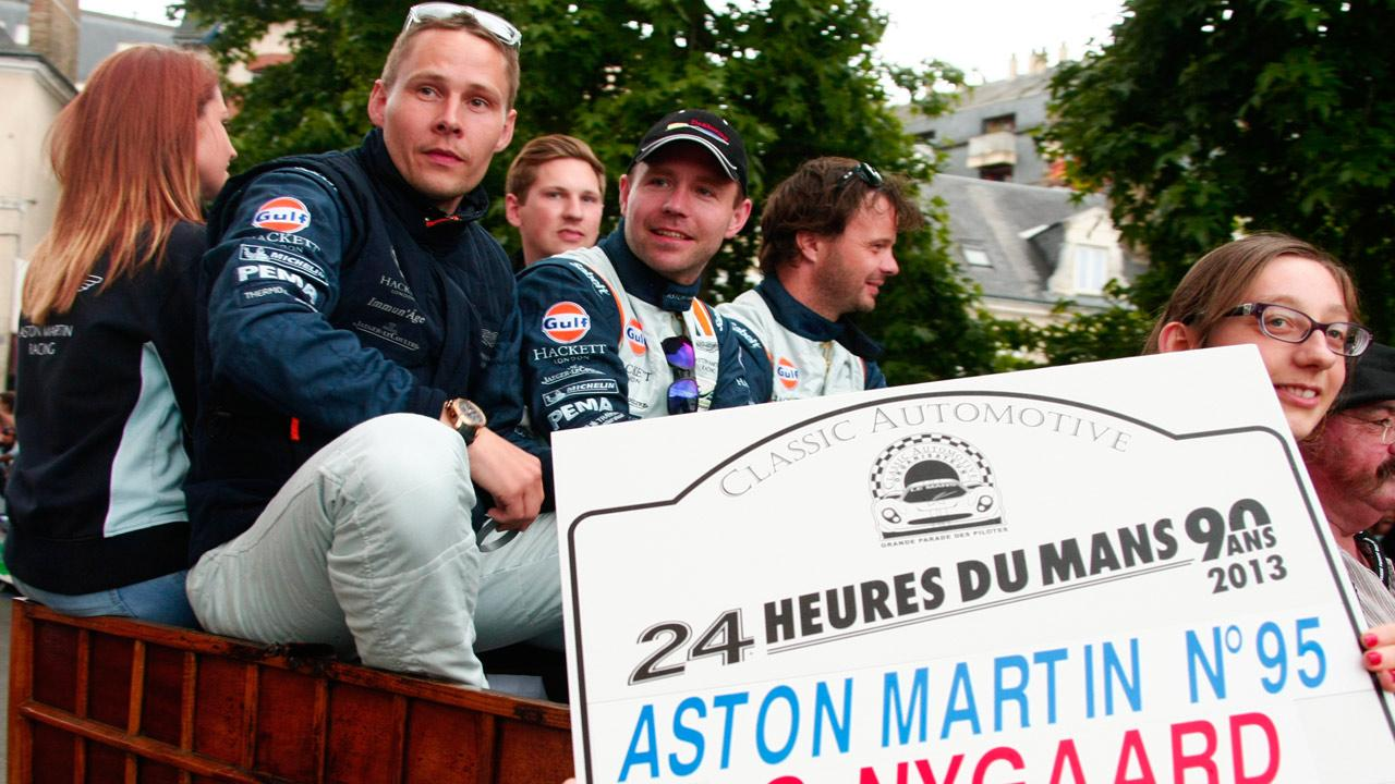 Danish driver Allan Simonsen, left, is seen during a parade on the eve of the 90th 24-hour Le Mans endurance race, in Le Mans, western France, in this Friday, June 21, 2013 photo.Michel Spingler