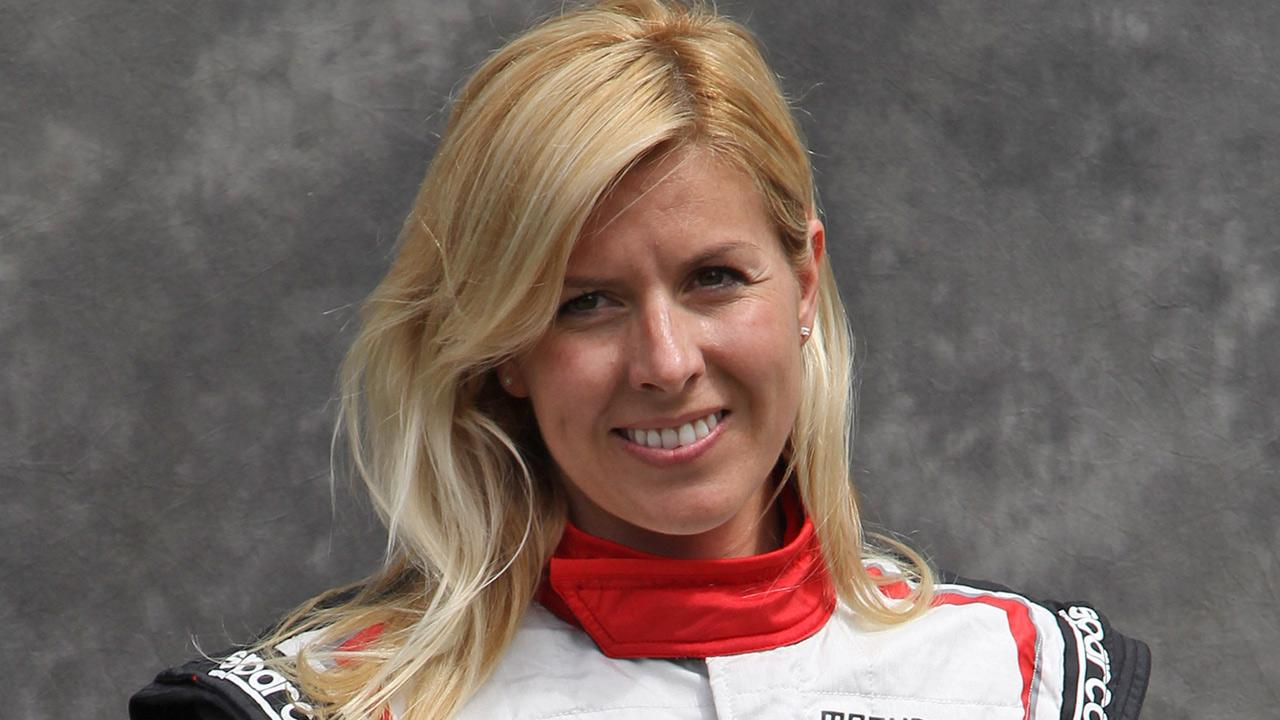 In this Thursday, March 15, 2012 file photo, Marussia test driver Maria de Villota of Spain poses for a photo ahead of the Australian Formula One Grand Prix at Albert Park in Melbourne, Australia. <span class=meta>(Rob Griffith)</span>