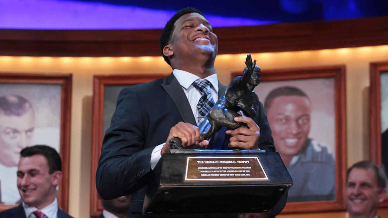 In this photo provided by the Heisman Trust, Florida State quarterback Jameis Winston hoists the Heisman Trophy after being named college footballs best player during the Heisman Trophy presentation in New York on Saturday, Dec. 14, 2013.