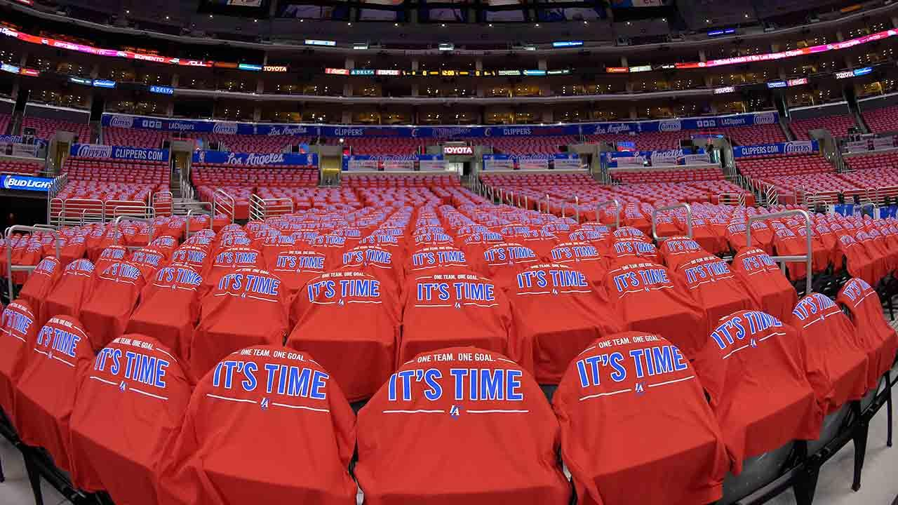 T-shirts cover empty seats before Game 7 of an opening-round NBA basketball playoff series between the Los Angeles Clippers and the Golden State Warriors, Saturday, May 3, 2014, in Los Angeles.