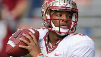 Florida State quarterback Jameis Winston warms up before an NCAA college football game against Florida in Gainesville, Fla., Saturday, Nov. 30, 2013.