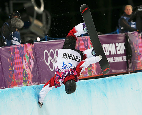 Canada's Katie Tsuyuki competes in the women's snowboard halfpipe semifinal at the Rosa Khutor Extreme Park, at the 2014 Winter Olympics, Wednesday, Feb. 12, 2014, in Krasnaya Polyana, Russia.
