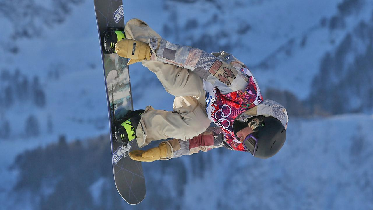 United States Sage Kotsenburg takes a jump during the mens snowboard slopestyle semifinal at the Rosa Khutor Extreme Park, at the 2014 Winter Olympics, Saturday, Feb. 8, 2014, in Krasnaya Polyana, Russia.