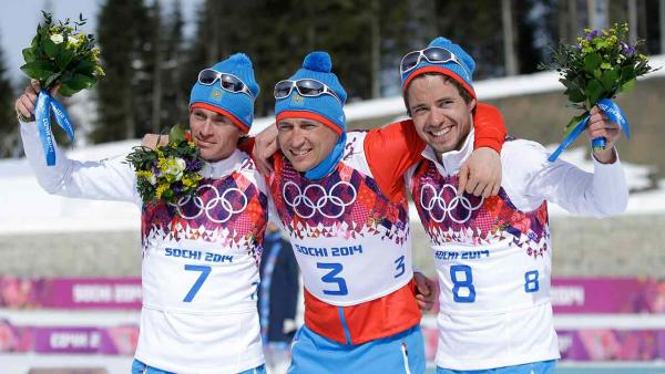 Russia's gold medal winner Alexander Legkov is seen during the flower ceremony of the men's 50K cross-country race at the 2014 Winter Olympics, Sunday, Feb. 23, 2014, in Krasnaya Polyana, Russia.
