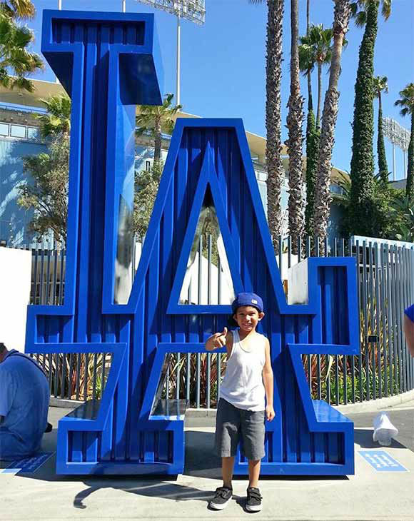 "<div class=""meta ""><span class=""caption-text "">Show us your Dodger love! Post your fan photos on our ABC7 Facebook page, and you might be featured on-air. You can also send us your photos on Twitter or Instagram with #abc7dodgers. LET'S GO DODGERS! (KABC Photo / Jeannie Guevara)</span></div>"