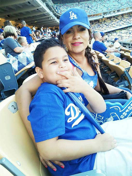 "<div class=""meta ""><span class=""caption-text "">Show us your Dodger love! Post your fan photos on our ABC7 Facebook page, and you might be featured on-air. You can also send us your photos on Twitter or Instagram with #abc7dodgers. LET'S GO DODGERS! (KABC Photo / Liz Magana)</span></div>"