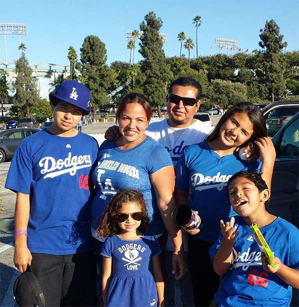 "<div class=""meta ""><span class=""caption-text "">Show us your Dodger love! Post your fan photos on our ABC7 Facebook page, and you might be featured on-air. You can also send us your photos on Twitter or Instagram with #abc7dodgers. LET'S GO DODGERS! (KABC Photo / Marta Romero)</span></div>"