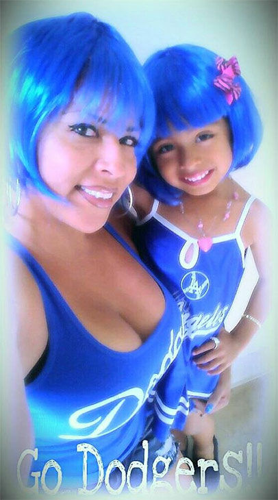 "<div class=""meta ""><span class=""caption-text "">Show us your Dodger love! Post your fan photos on our ABC7 Facebook page, and you might be featured on-air. You can also send us your photos on Twitter or Instagram with #abc7dodgers. LET'S GO DODGERS! (KABC Photo / Alma Surarez)</span></div>"