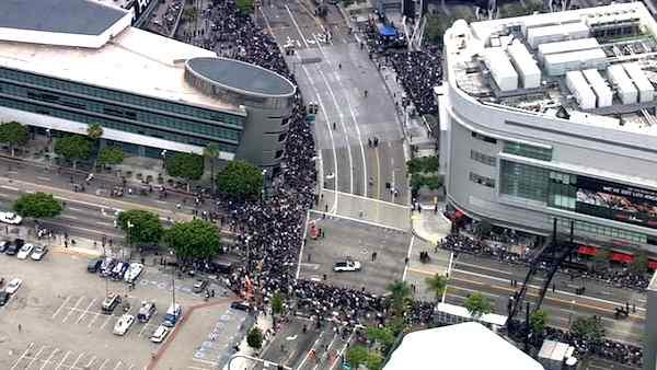 Hockey fans crowd downtown Los Angeles to celebrate the L.A. Kings' first-ever Stanley Cup win in a victory parade on Thursday, June 14, 2012.