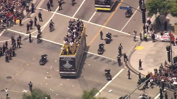 The Los Angeles Kings players and their families roll down Figueroa Street in double-decker buses in downtown Los Angeles to celebrate the team's first Stanley Cup win with a victory parade on Thursday, June 14, 2012.