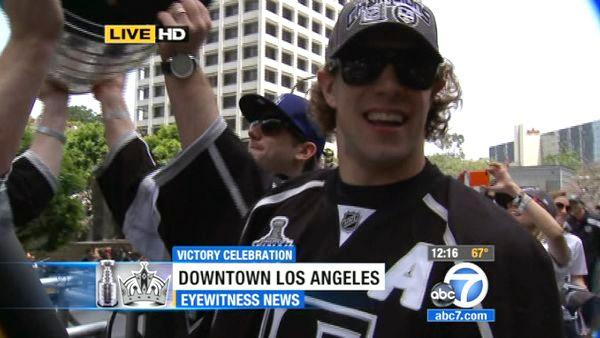 Los Angeles Kings center Anze Kopitar rides atop a bus during a parade celebrating the team's NHL hockey Stanley Cup championship in Los Angeles, Thursday, June 14, 2012.