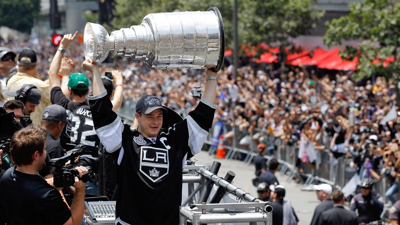 Los Angeles Kings Dustin Brown hoists the Stanley Cup during a parade celebrating the teams NHL hockey Stanley Cup championship in Los Angeles, Thursday, June 14, 2012.Jae C. Hong
