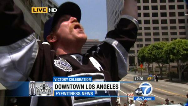 Los Angeles Kings' Matt Greene cheers during a parade celebrating the team's NHL hockey Stanley Cup championship in Los Angeles, Thursday, June 14, 2012.
