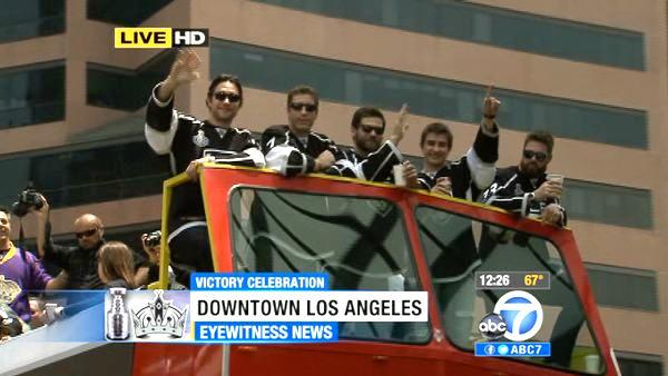 Los Angeles Kings players wave from atop a bus during a parade celebrating the team's NHL hockey Stanley Cup championship in Los Angeles, Thursday, June 14, 2012.