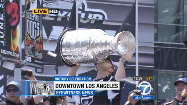 Los Angeles Kings' Dustin Brown kisses the Stanley Cup during a parade celebrating the team's NHL hockey Stanley Cup championship in Los Angeles, Thursday, June 14, 2012.