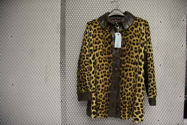Lisa Naumu, 49, of San Diego was arrested for allegedly selling an $8,000 leopard skin coat. The arrests are a result of Operation Cyberwild, a task force investigation that led to the arrests of 10 people in California, as well as two individuals in Neva