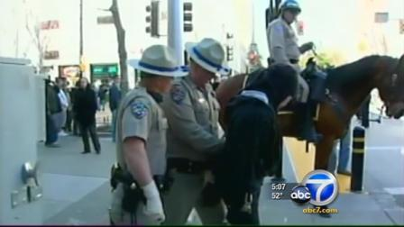 At least two officers were injured Monday when police clashed with Occupy protesters at the state Capitol.