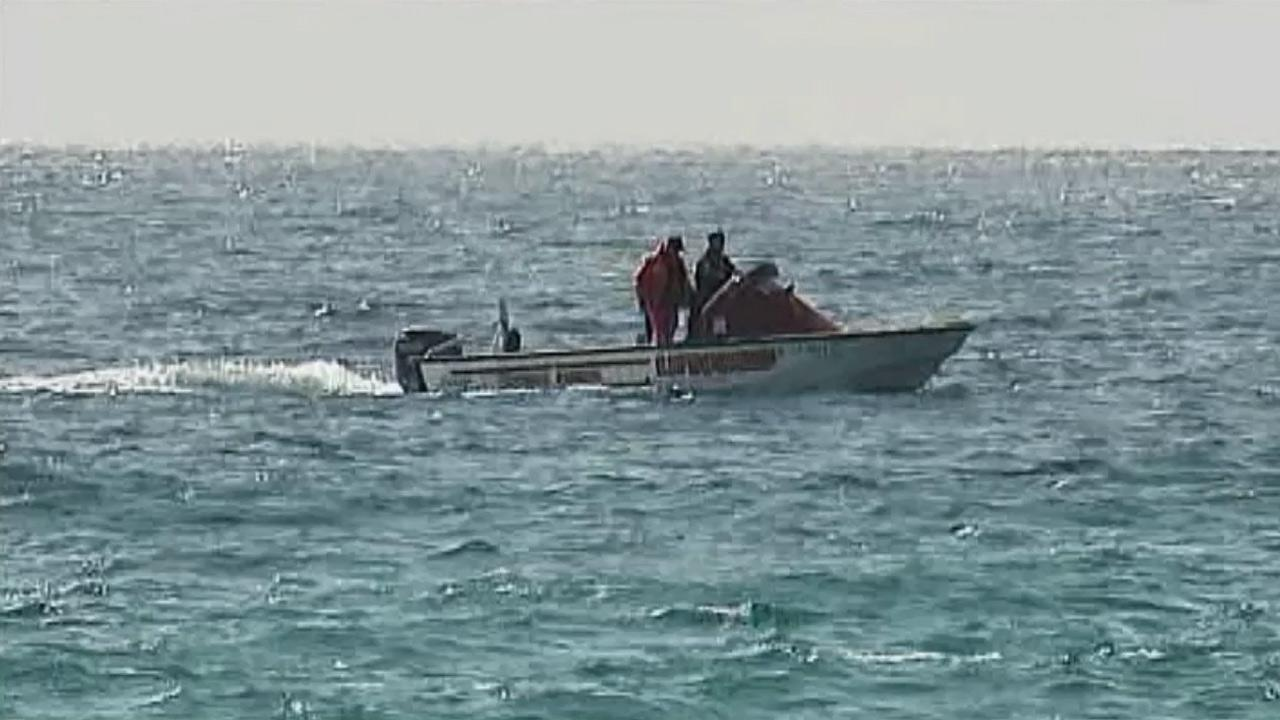 Lifeguards search the waters off the coast of La Jolla Shores after a shark was spotted on Monday, July 2, 2012.