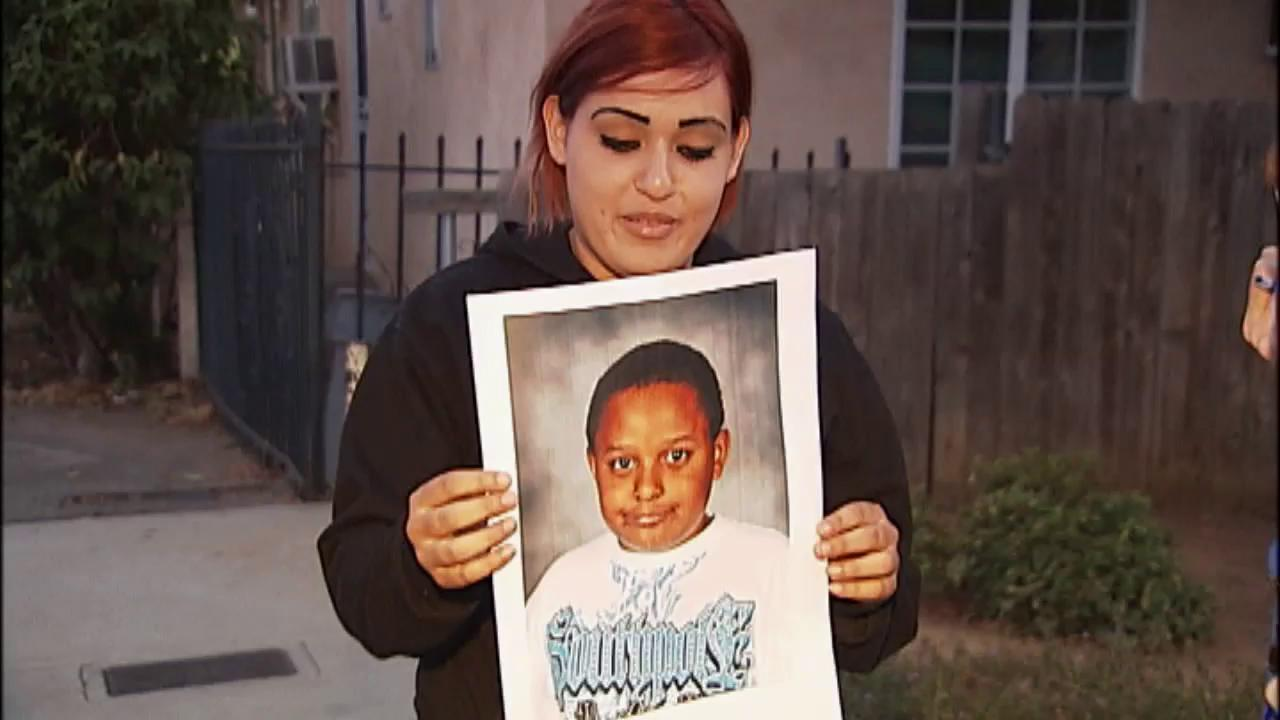 Diana Rios holds up a picture of her brother, 10-year-old Andres Adams, who drowned at Yosemite National Park on Wednesday, Aug. 15, 2012.
