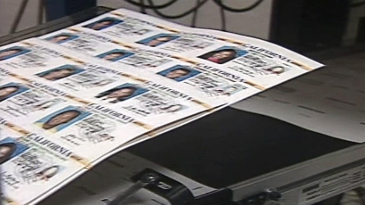 This file photo shows the production of California drivers licenses.