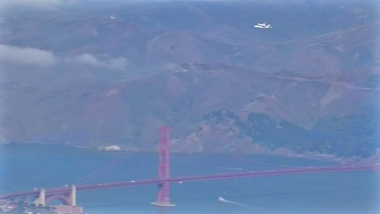 The space shuttle Endeavour flies over the Golden Gate Bridge in the San Francisco Bay on Friday, Sept. 21, 2012.