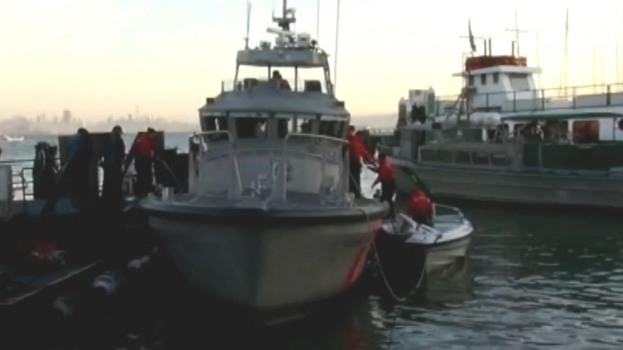 U.S. Coast Guards are seen at the scene of a crash after a Golden Gate Ferry crashed with a 22-foot-long pleasure boat in San Francisco Bay on Saturday, Feb. 17, 2013. Two people were injured.