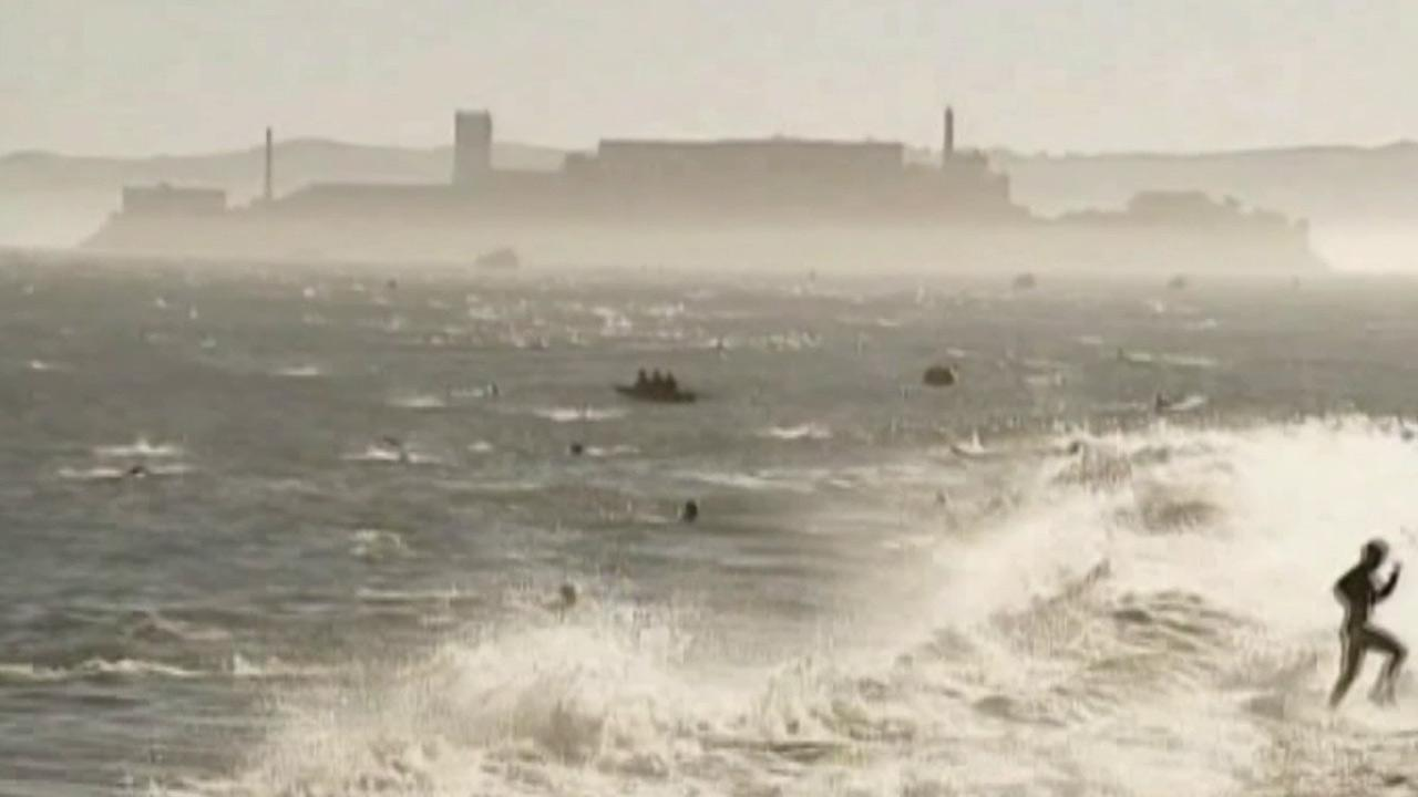 Competitors are seen swimming from the island home of the former federal prison to the San Francisco coast during the 2012 Escape from Alcatraz Triathlon.
