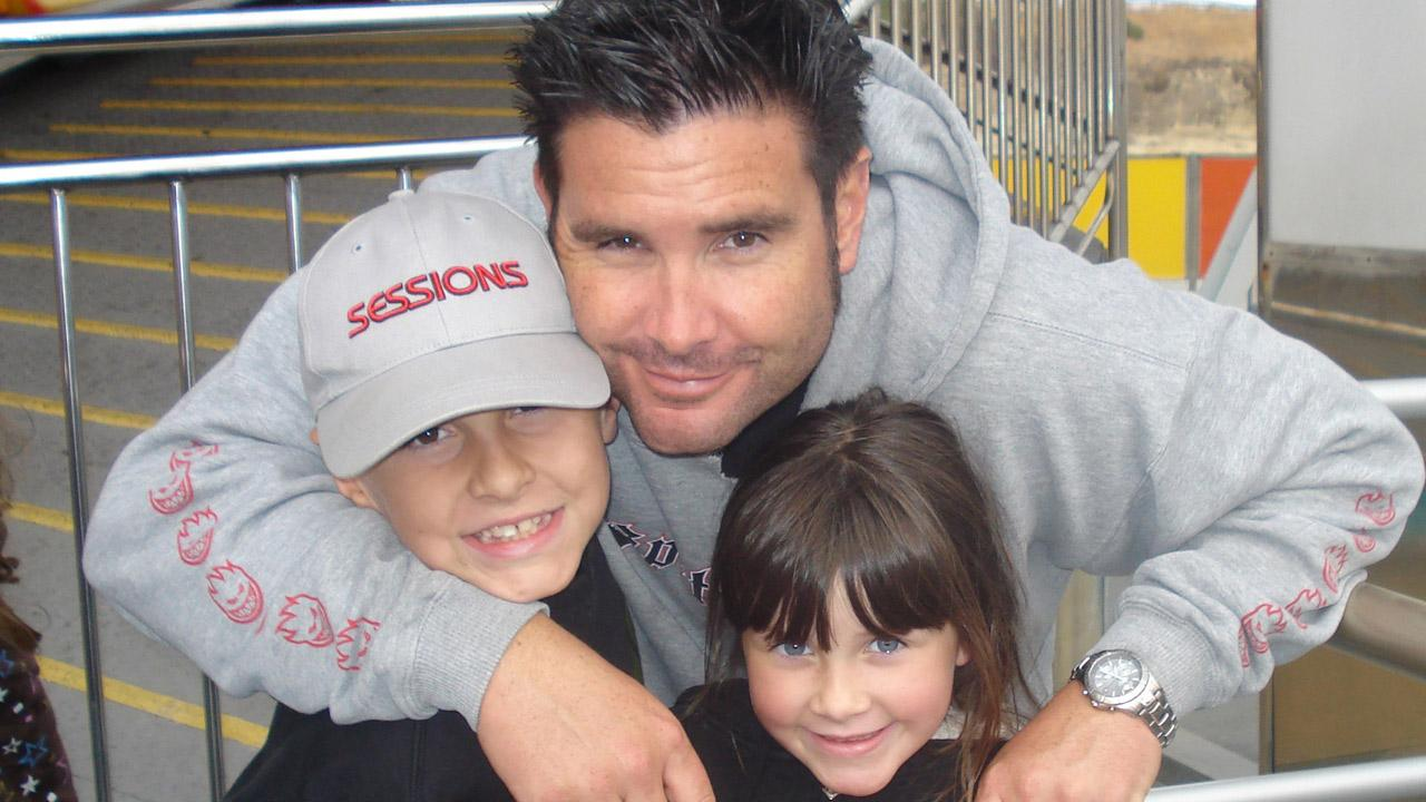 This undated image provided Tuesday April 5, 2011 by John Stow shows Bryan Stow holding his son and daughter.