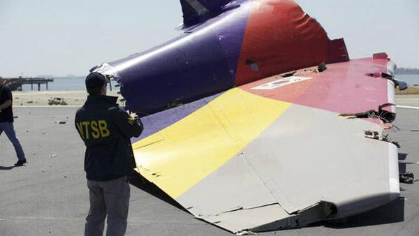 A National Transportation Safety Board investigator is at the scene of the Asiana Airlines Boeing 777 that crashed at SFO on Saturday, July 6, 2013.