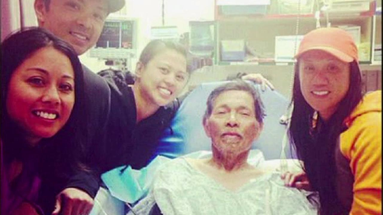 Gene Penaflor is seen in the hospital surrounded by his family. He was lost for 19 days in the Mendocino National Forest before he was found Saturday, Oct. 12, 2013.