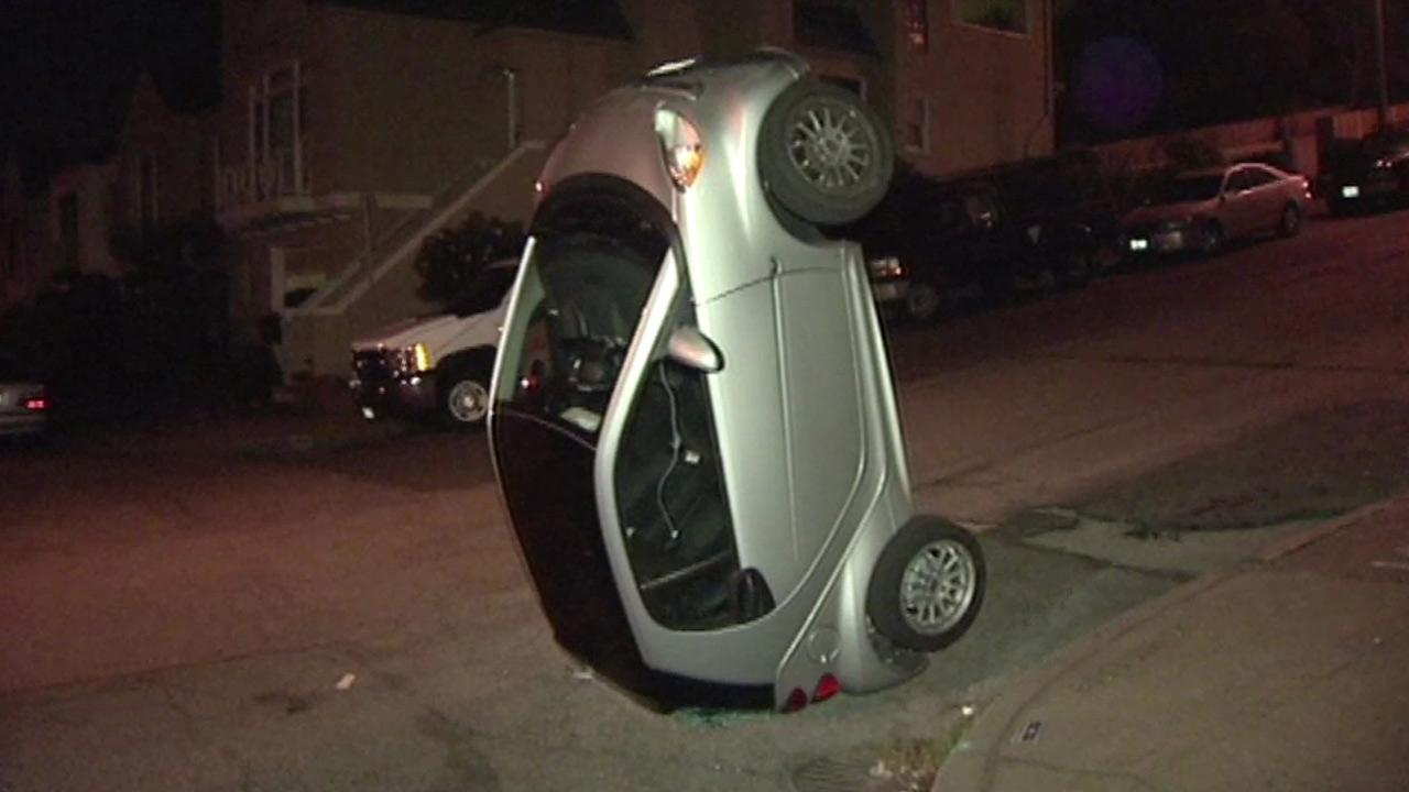 San Francisco police are investigating why vandals flipped four Smart cars around the city.