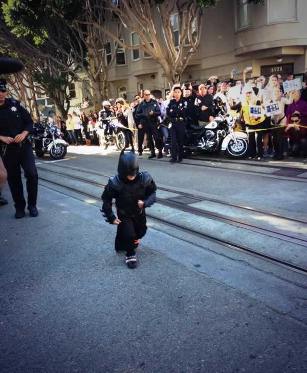 Batkid rescues a damsel in distress from the cable car tracks in Nob Hill area of San Francisco, Friday, Nov. 15, 2013. San Francisco turned into Gotham City on Friday, as city officials helped fulfill Miles Scott&#39;s wish to be &#39;Batkid.&#39;   Much like Batman battles villains, Miles has been fighting his own battle with leukemia since he was just a year old. <span class=meta>(Make-A-Wish of the Greater Bay Area)</span>