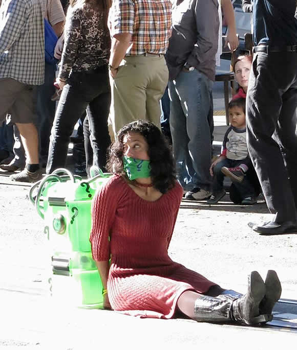 A damsel in distress waits for Batkid to come and save the day in &#39;Gotham City,&#39; in San Francisco on Friday, November 15, 2013. <span class=meta>(KGO-TV)</span>