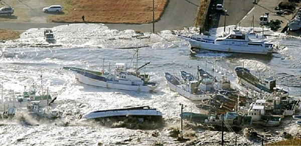 Fishing boats are damaged in Asahi, Chiba prefecture (state), Japan, after a ferocious tsunami unleashed by Japan's biggest record