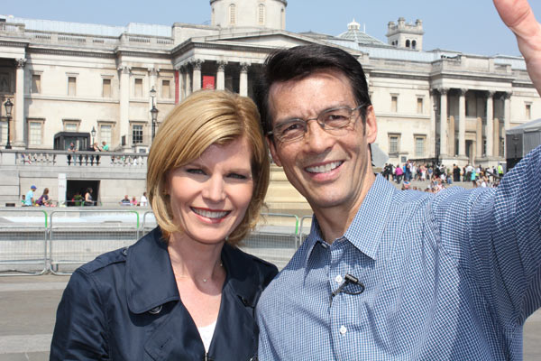 Michelle Tuzee and David Ono pose in front of Trafalgar Square, where thousands of people will gather to watch the royal wedding on Friday, April 29, 2011. <span class=meta>(KABC Photo)</span>