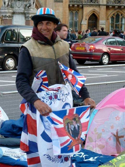 Royal wedding fans hold souvenirs of Prince William and Kate Middleton, who are set to get married at Westminster Abbey in London on April 29.