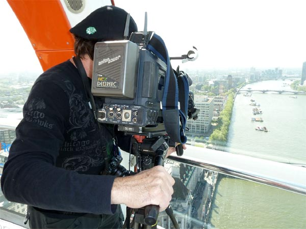 ABC7 photographer Shawn McCarthy shooting footage from the London Eye, a huge Ferris wheel with some of the best views of the city.