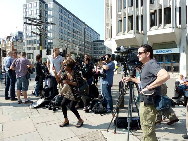 Members of the media set up outside Westminster Abbey where Prince William and Kate Middleton are due to get married on Friday, April 29. <span class=meta>(KABC)</span>