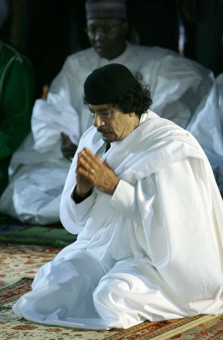 In this Thursday, Feb. 25, 2010 file photo, Libyan leader Moammar Gadhafi is seen during prayers after delivering a speech in the city of Benghazi, Libya.  <span class=meta>(AP Photo&#47;Abdel Meguid Al-Fergany)</span>