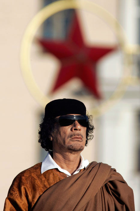 In this photo taken Monday, Nov. 3, 2008, Libya&#39;s leader Moammar Gadhafi attends a wreath laying ceremony in the Belarus capital Minsk.  <span class=meta>(AP Photo&#47;Sergei Gr)</span>